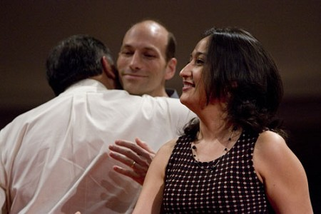 Mike Gonzalez, left, former missionary to Spain and an IMB trustee from Texas, hugs his son-in-law, Joel Jolley, after presenting him and his wife, Angela, with their appointment certificates. The Jolleys, who will be serving in Spain, were appointed with 82 others July 17 at Grove Avenue Baptist Church in Richmond, Va.  Photo by Bill Bangham.